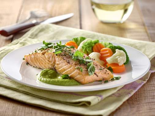 Roasted sesame salmon and pea coulis with garden herbs
